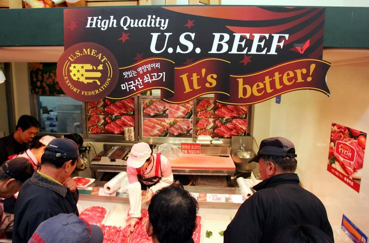 Customers buy imported U.S. beef at a store in Seoul. South Korea banned both U.S. and Canadian beef imports in 2003 amid concerns over BSE, or mad cow disease. The sale of U.S. beef has resumed while Korea continues to ban Canadian beef with the same BSE risk status. (Chung Sung-Jun/Getty Images)
