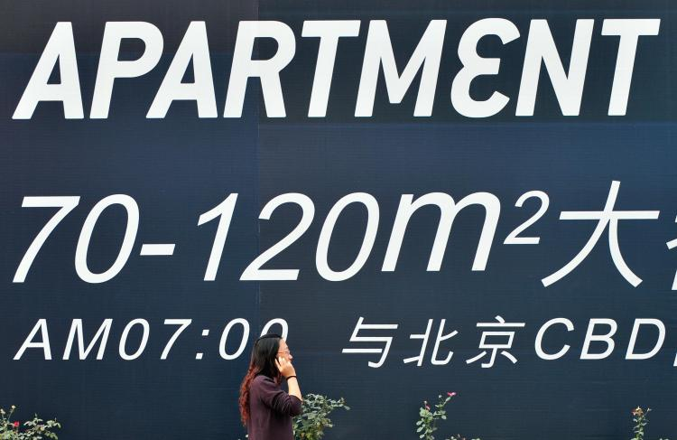Many real estate agents have started using large discounts to attract buyers in Beijing. (Frederic J. Brown/AFP/Getty Images)