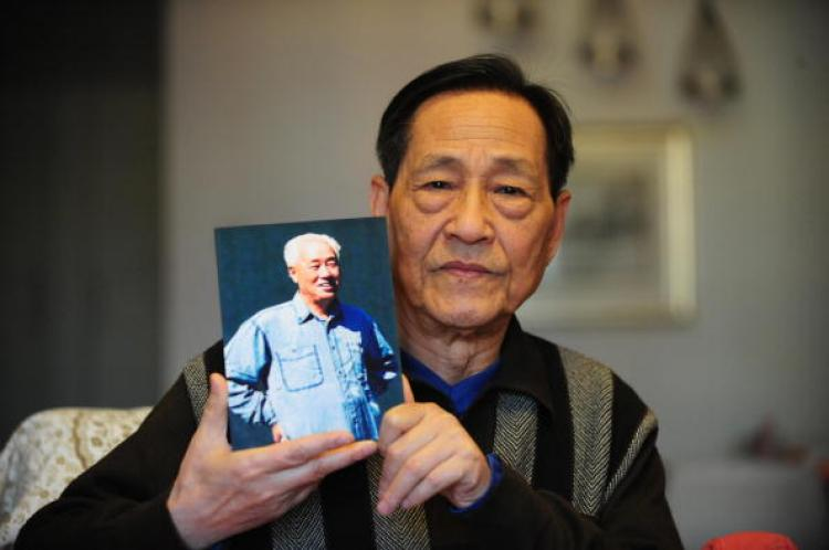 Bao Tong holds up a photo of Zhao in his home in Beijing. (Frederic J. Brown/AFP/Getty Images)