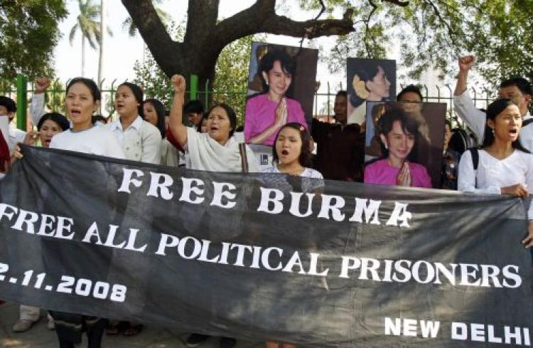 Burmese pro-democracy supporters in New Delhi hold portraits of Nobel Peace Prize Laureate Aung San Suu Kyi at a protest against the Burmese military junta on November 22, 2008. They are calling for global actions against the junta for its severe convictions and unfair trials and demanding the release of Suu Kyi and all political prisoners. (Raveendran/AFP/Getty Images)