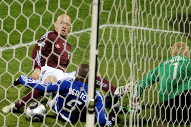 Colorado striker Conor Casey jabs home the first goal for the Rapids. (Harry How/Getty Images)