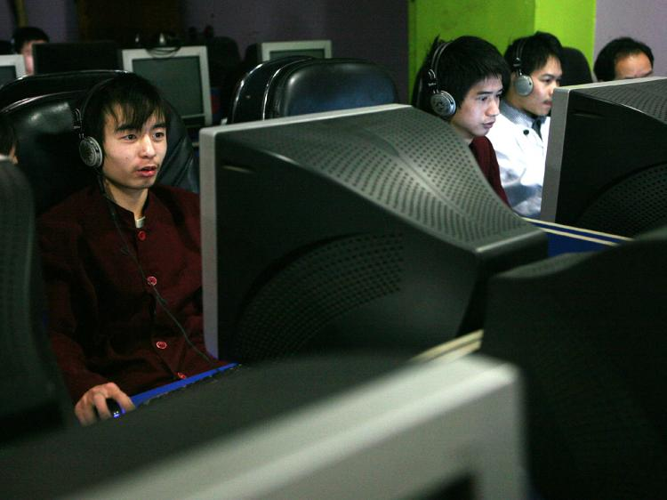 Chinese youths surf the Web in an Internet cafe in Chongqing Municipality, China. (China Photos/Getty Images)