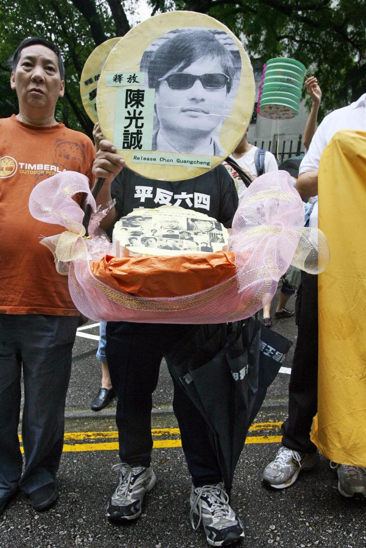 Chen Guangcheng's picture being held by a pro-democracy activist during a protest in Hong Kong. (Mike Clarke/AFP/Getty Images)