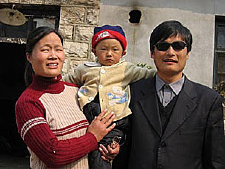 Blind Chinese activist Chen Guangcheng with his family prior to his serving a four year prison sentence. (STR/AFP/Getty Images)