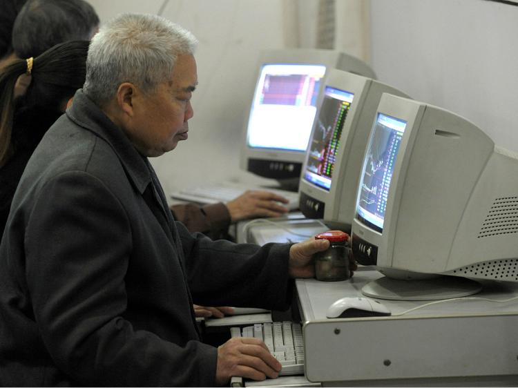 The Chinese regime has mandated that all computers sold in China must come with pre-installed censorship software. (Liu Jin/AFP/Getty Images)
