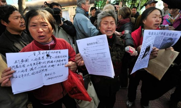 Agitated Chinese petitioners show documents during a gathering outside a courthouse in Beijing, China on April 3, 2008.