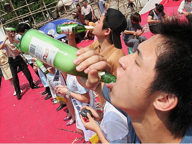 Chinese youth takes part in a beer drinking competition in Nanjing of Guangxi Autonomous Region, China.   (China Photos/Getty Images)