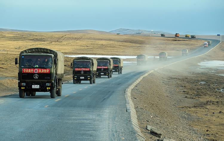 A convoy of military trucks bringing quake relief goods travels along the Qinghai-Tibet plateau on April 19, 2010 headed the Jiegu quake zone that was hit by a 6.9 magnitude earthquake on April 14. (Frederic J. Brown/AFP/Getty Images)