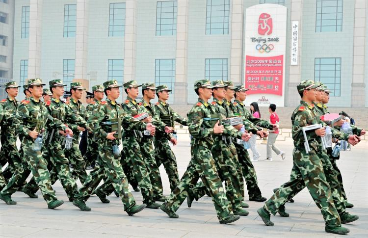 Chinese paramilitary policemen patrol past the Beijing Olympics countdown clock on the edge of Tiananmen Square in Beijing on April 29, 2008. Leading up to the Olympics the Chinese regime cracked down on groups deemed dissidents. (Teh Eng Koon/AFP/GETTY IMAGES)