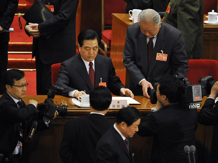 Communist Party chief Hu Jintao (C) and the rest of the CCP regime spend more than one hundred billion dollars on travel every year.   (Peter Parks/AFP/Getty Images)