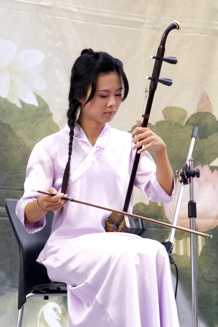 ERHU: Sound is produced by the bow's hair played on the strings. (Renjiun Wang/The Epoch Times)
