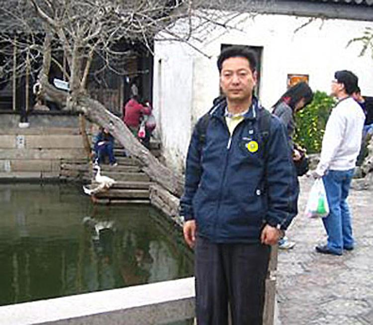 Guo Quan, the recently arrested chairman of the China Democracy Party, describes his love for China like a moth that flies into fire without hesitation.  (Courtesy of Guo Quan)