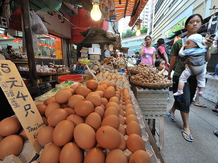 A vendor sells eggs from Thailand at a market stall in Hong Kong. Chinese eggs are now suspect after melamine-contaminated eggs turned up in Hong Kong.    (Mike Clarke/AFP/Getty Images)