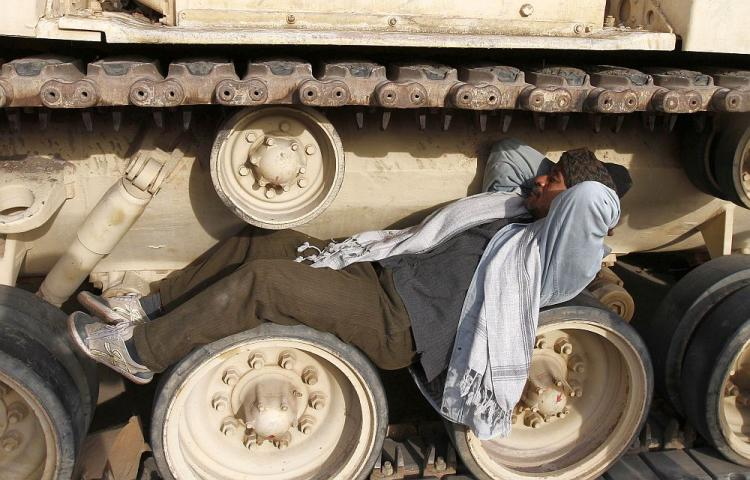An Egyptian anti-government demonstrator sleeps on the wheels of a military vehicle at Cairo's Tahrir square on February 6, 2011 on the 13th day of protests calling for the ouster of President Hosni Mubarak. (AFP/Getty Images)