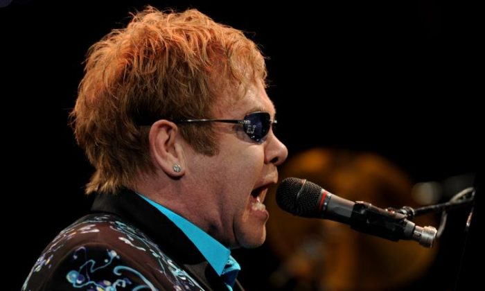 Elton John performs onstage at The Citizens Business Bank Arena on Nov. 5, 2010 in Ontario, California. (Kevin Winter/Getty Images)