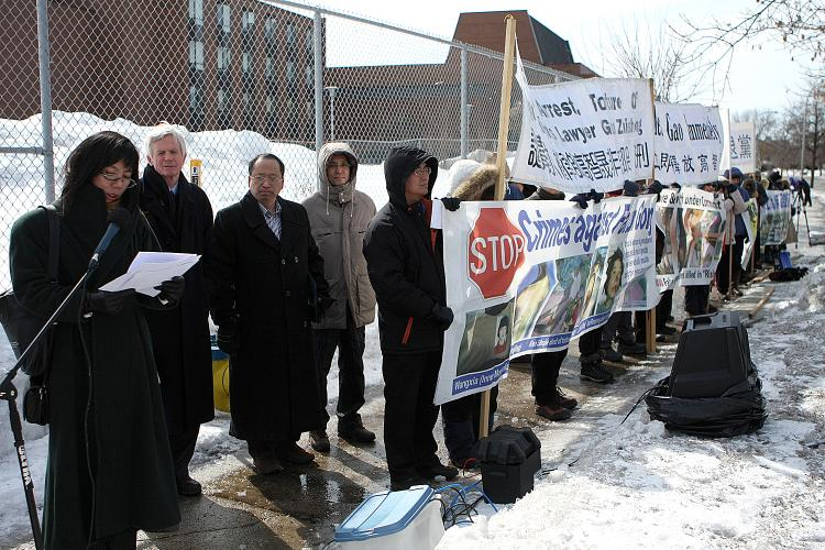 Grace Wollensak, speaking for the Falun Dafa Association of Canada at a rally in front of the Chinese Embassy, calling for the release of renowned human rights lawyer Gao Zhisheng. Beside her is former Secretary of State for Asia-Pacific David Kilgour.  (Samira Bouaou/The Epoch Times)