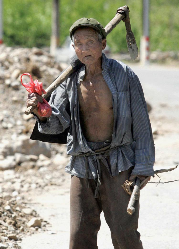 An elderly Chinese farmer in the outskirts of Beijing, 2007.  (STR/AFP/Getty Images)