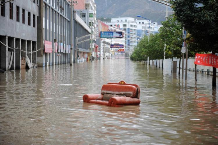An old couch floods down a street after the massive landslide in Zhouqu, northwest China's Gansu province on August 12, 2010. (STR/AFP/Getty Images)