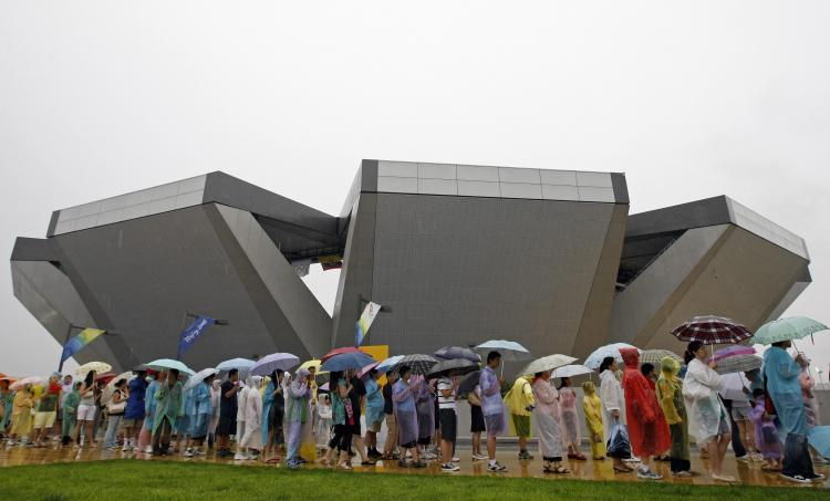 Spectators queue to get food at the centre court of the Olympic Green Tennis Centre in Beijing.   (Behrouz Mehri/AFP/Getty Images)