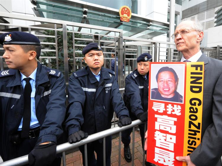 Solicitor John Clancey (R), a member of a lawyers concern group protests for the release of Beijing human rights lawyer Gao Zhisheng outside the China Liaison office in Hong Kong on February 4, 2010. Gao was taken from his home on February 4, 2009 and his whereabouts are still unkown. (Mike Clarke/AFP/Getty Images)