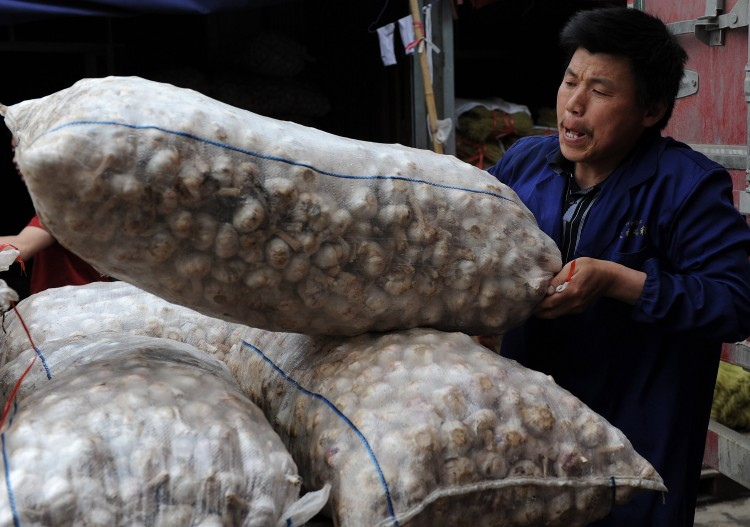 Food prices in China are soaring, but garlic prices have been plummeting. (AFP/AFP/Getty Images)