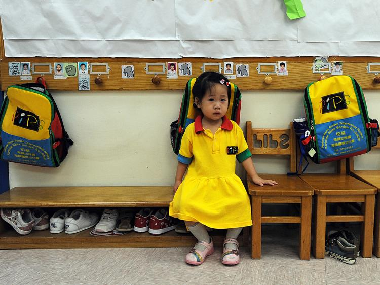 WHEN I GROW UP ... Is this Chinese kindergarten student's best option for the future, to become a corrupt official? (Mike Clarke/AFP/Getty Images)