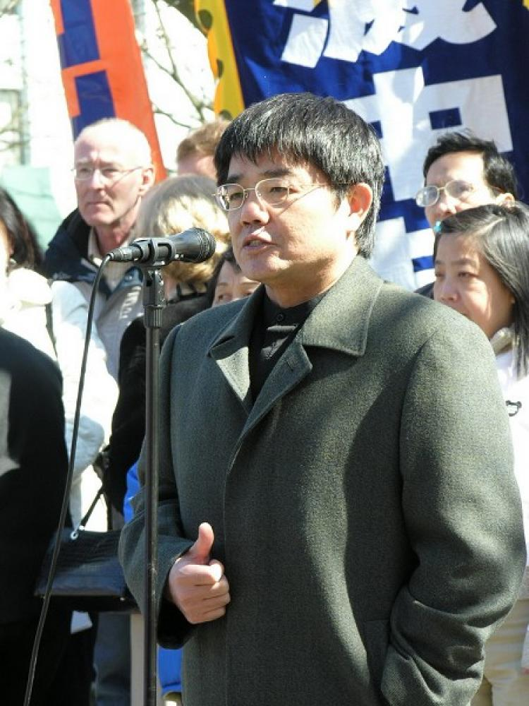 Chinese human rights lawyer Guo Guoting speaking at a rally against the Chinese Communist Party. (The Epoch Times)