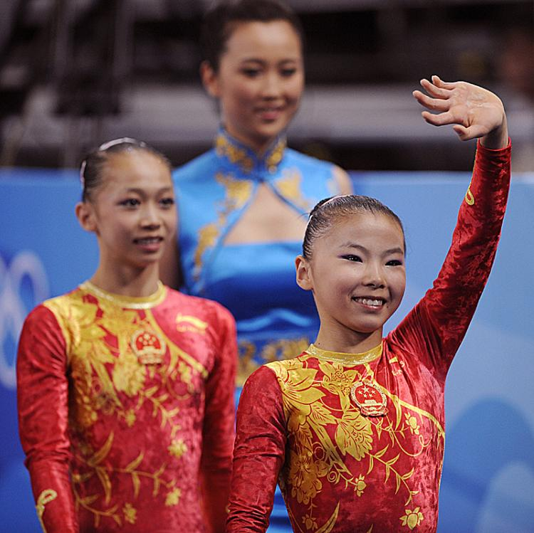 China's He Kexin (R)and Yang Yilin (L) might lose their Olympic medals for being underage.  (Franck Fife/AFP/Getty Images)