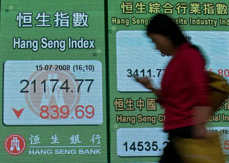 The Chinese stock market fell 4.5%, disappointing those who expected a boost from the Olympics.  (Andrew Ross/AFP/Getty Images)