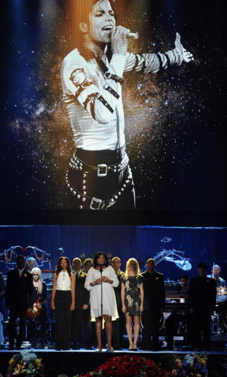 Artists perform during the memorial service for music legend Michael Jackson at the Staples Center in Los Angeles, California on July 7, 2009. (Gabriel Bouys/AFP/Getty Images)
