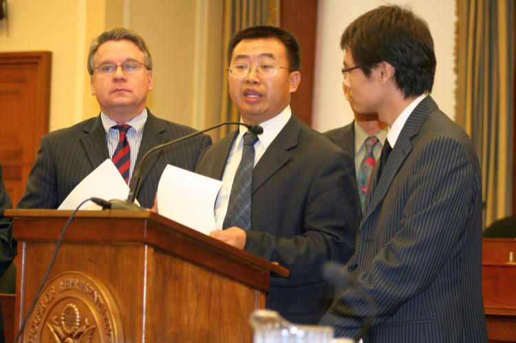 Jiang Tianyong appears at the Tom Lantos Human Rights Commission hearing last week, Nov. 10, on Capitol Hill regarding China's one-child policy. Standing to the left is Congressman Chris Smith from New Jersey. (Gary Feuerberg/The Epoch Times)