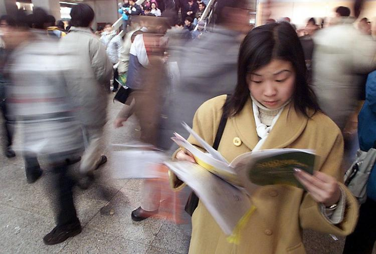 The employment rate of college students published by China Ministry of Education is being disputed. Many college students have posted their opinions on a blog to expose the data is fake. (Stephen Shaver/AFP/Getty Images)