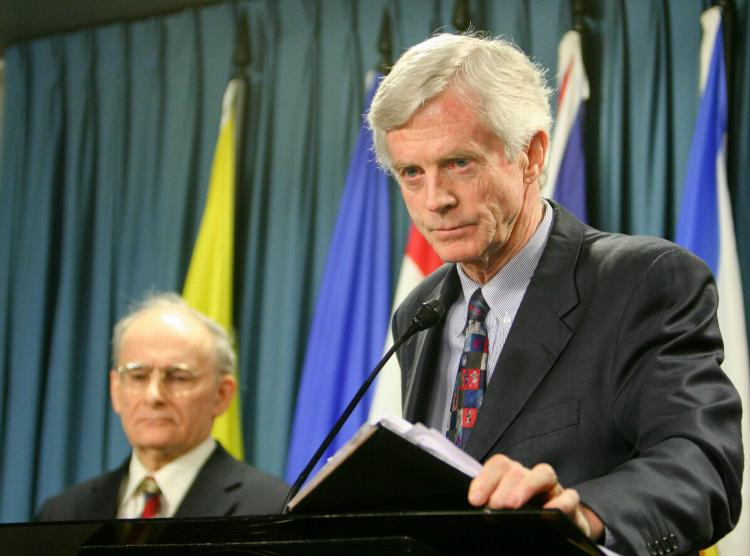 Former Canadian cabinet minister and Crown Prosecutor David Kilgour presents a revised report about the murder of Falun Gong practitioners in China for their organs, as report co-author lawyer David Matas listens in the background, on Jan. 31, 2007.  (Matthew Hildebrand/The Epoch Times )