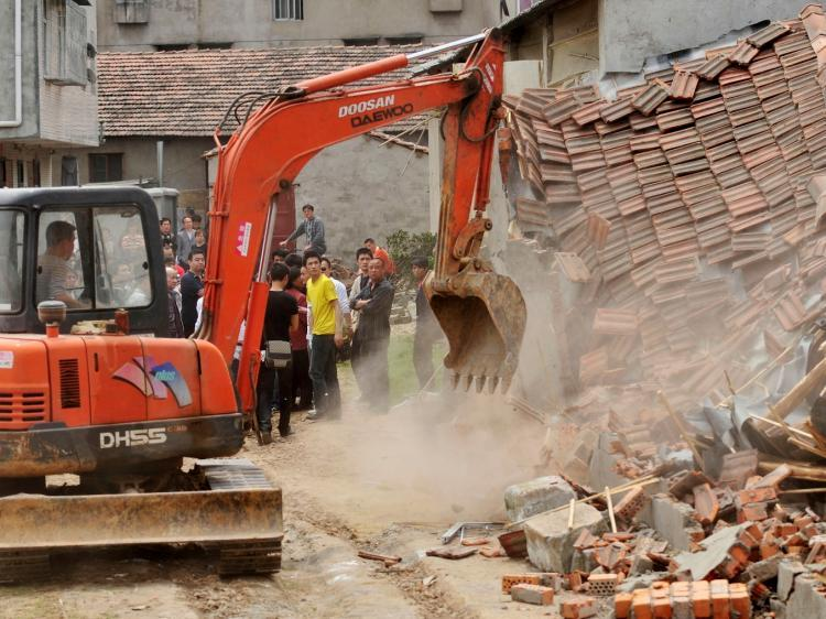 Chinese authorities demolish houses which are claimed illegal by the local government in Wuhan, central China's Hubei province on May 7, 2010. Land seizures have been a problem for years in China and forced evictions have not been uncommon. (STR/AFP/Getty Images)