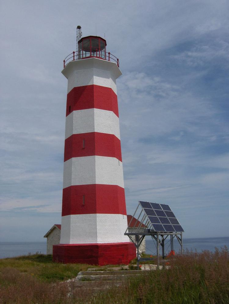 Sambro Island lighthouse after it was freshly painted for its 250th birthday celebration in 2008. Located at the entrance to Halifax Harbour, Nova Scotia, Sambro is the oldest surviving lighthouse in North America and a Canadian National Historic Site. It is one of the 970 lighthouses declared surplus by the government. (Barry MacDonald)