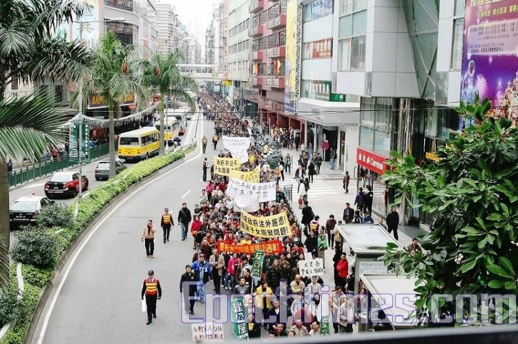 A mass rally and march is held in Macau on the 10th anniversary of Macau's return to Chinese rule.  (The Epoch Times)