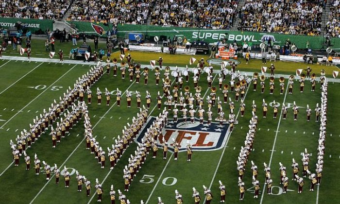 A marching band performs during the pre-game show prior to the start of Super Bowl XLIII between the Arizona Cardinals and the Pittsburgh Steelers at Raymond James Stadium in Tampa, Florida, on Feb. 1, 2009. (Doug Benc/Getty Images)