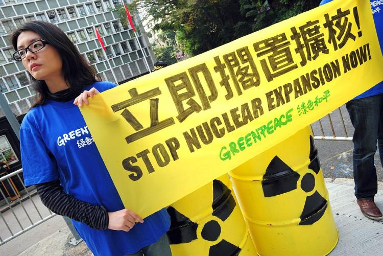 Members of environmental action group Greenpeace hold up an anti-nuclear banner in front of the Central Government offices in Hong Kong on March 22, 2011 to raise concerns about nuclear power expansion in the southern Chinese territory. The group urged members of the government to abandon a proposal last year to increase the local intake of nuclear power to 50 percent in 2020, highlighted by the nuclear crisis at the Fukushima nuclear plant north of Tokyo in the aftermath of the March 11 earthquake and tsunami. (AFP/Getty Images)