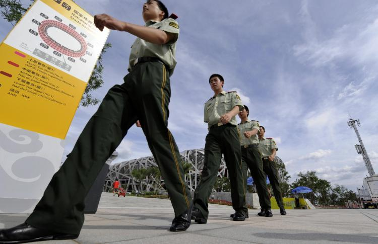 Chinese security personnel patrol the Olympics ground on Aug. 1, 2008, in preparation for the Beijing Olympics. Free speech activists and other citizens detained in connection with the Beijing Olympics are still being held six months after the games. (Jewel Samad/AFP/Getty Image)