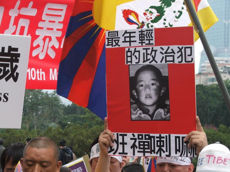 Tibetan activists hold a portrait of Gendun Choekyi Nyima, the young boy who was selected by the Dalai Lama as the 11th Panchen Lama. (David Reid)