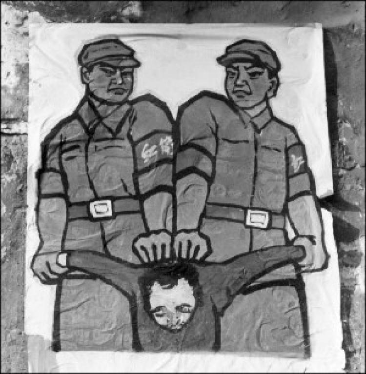 This poster, displayed in late 1966 in Beijing, shows Red Guards how to deal with a so-called 'enemy of the people' during the Cultural Revolution. (Jean Vincent/AFP/Getty Images)