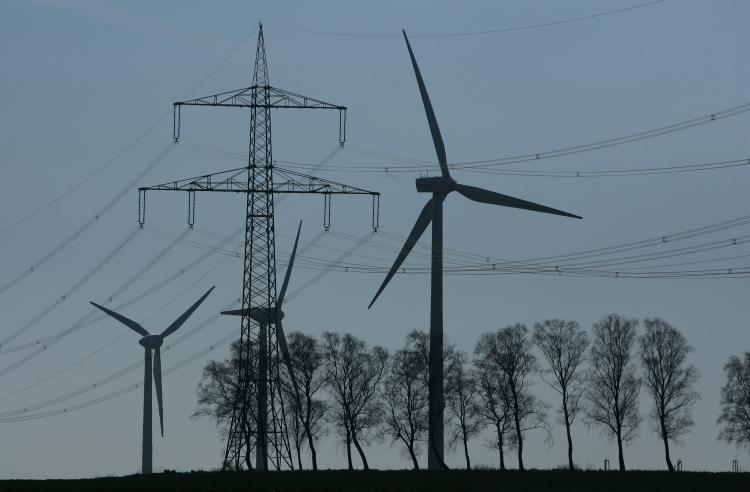 In this file photo, wind turbines generating electricity are silhouetted together. The U.S. electric grid system has been reported to have been heavily compromised by hackers from China and other countries. (Sean Gallup/Getty Images)