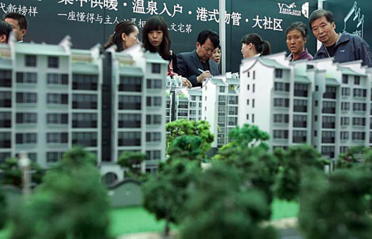 HIGH PRICES: Due to soaring housing prices, more and more Chinese families have to use up the accumulated wealth of a lifetime or even the savings of several generations of family members in to buy an apartment. (Getty Images)