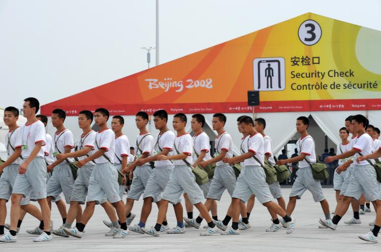 Chinese security personnel march towards the National Stadium, also known as the 'Birds Nest' in Beijing, on August 5, 2008.  (Christophe Simon/AFP/Getty Images)