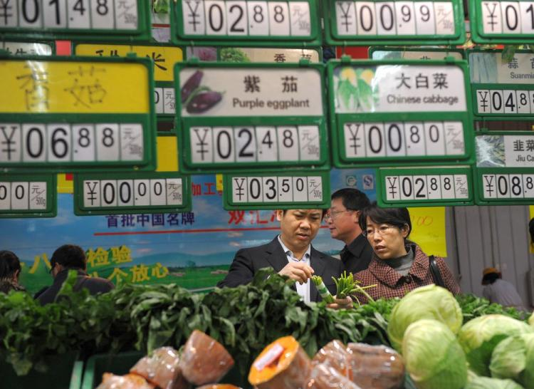 Chinese shoppers gather to buy vegetables at a supermarket in Hefei, east China Anhui province on Dec. 10, 2010. China's consumer prices rose at the fastest pace in more than two years in November. (STR/AFP/Getty Images)