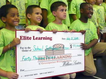 BIG GIFT: Children from the School Settlement Association's summer program gladly accept a $40,000 grant from a Brooklyn educational organization to enhance their summer field trips. ()
