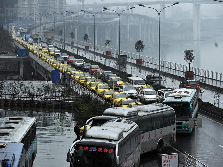 Taxis queue up to get their fuel tanks filled in southwest China's Chongqing municipality on Nov. 18. Taxi drivers went on strike in early November to protest shortages of fuel and competition from unlicensed cabs, among other issues. The drivers on strike became some of the targets of Bo Xilai's 'hitting the black' campaign, said to be against gangsters. (AFP/Getty Images)