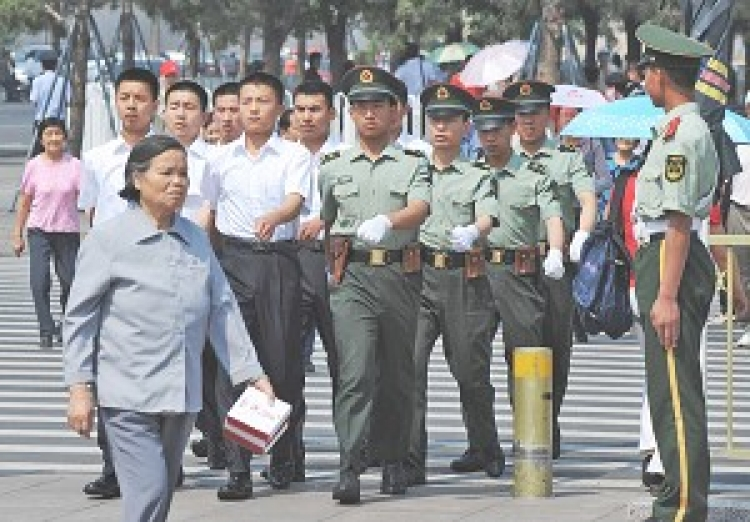 Chinese paramilitary police march into Tiananmen Square in Beijing on June 4, 2008. China has stepped up security in central Beijing ahead of the Olympics. ()