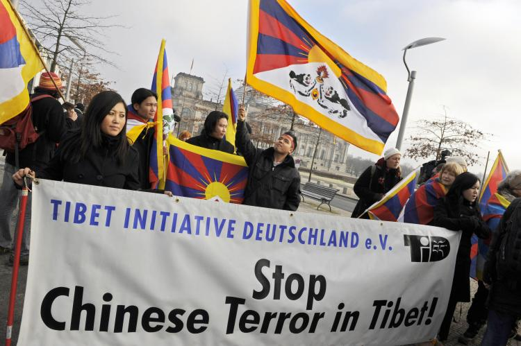 A protest group demonstrates for a free Tibet during a visit by Chinese Premier Wen Jiabao to Berlin on January 29.  (Barbara Sax/AFP/Getty Images)