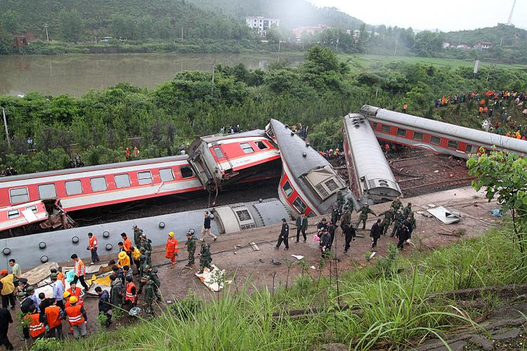 Rescuers check the twisted wreckage of a train that derailed in Dongxiang County, in eastern China's Jiangxi Province. The train was headed from Shanghai to the tourist city of Guilin. (AFP/Getty Images)